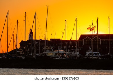 Sunset with skyline silhouet Urk, fishing village in the Netherlands