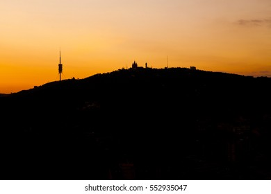 sunset skyline of tibidabo, barcelona, catalonia, spain