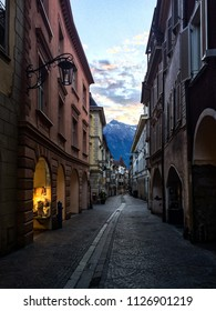 Sunset at small streets of Meran with Italian Alps as background, South Tyrol, Italy