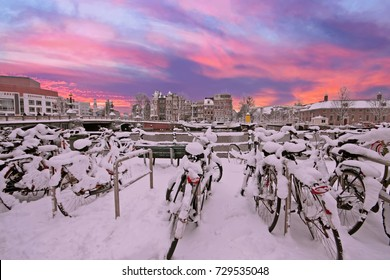 Sunset in snowy Amsterdam in the Netherlands at the Amstel in winter