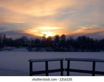 Sunset at a snowy lake.