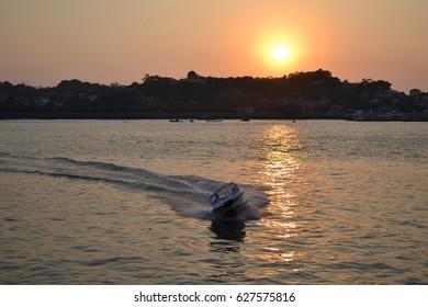 Sunset speed boat