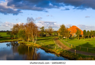 Sunset spring village river landscape. Farm house river scene. River farm house in spring. Farm house river water reflection