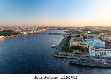 Sunset in St. Petersburg from high. City panorama. Neva river. Cruiser Aurora