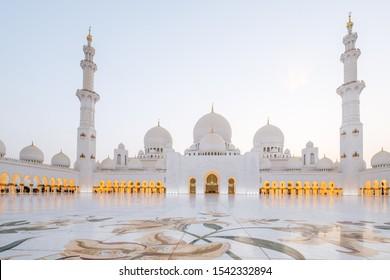 Sunset star burst at Sheikh Zayed Grand Mosque Abu Dhabi UAE