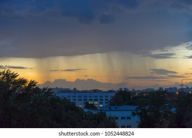 Sunset with storm cloudscape and rain shadow over skyline. Moscow, Russia.