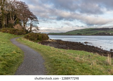 Sunset in Strangford lough with walking trail and farms in background, Northern Ireland, UK