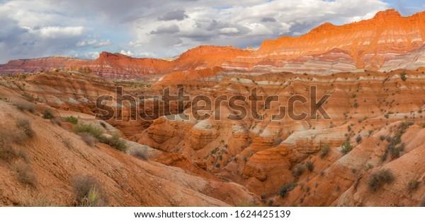 Sunset  in striped Badlands near Paria Movie Set in Kabab, Utah - USA