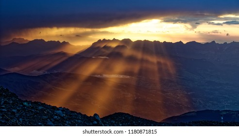 Sunset in the summer alps during the ascent to Monblan at the Tete Rousse