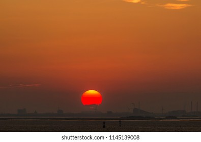 Sunset in the summer evening over Oresund and Copenhagen Denmark from a hill on the Swedish side in Malmo when July 27, 2018
