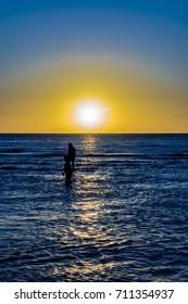Sunset summer scene at beach at iemanja worship celebration in Montevideo city, Uruguay