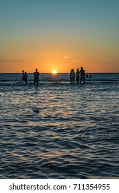 Sunset summer scene at crowded beach at iemanja worship celebration in Montevideo city, Uruguay