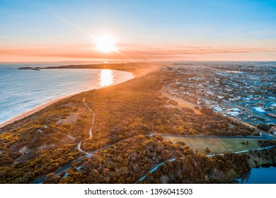 Sunset with sun flare over Warrnambool town and ocean in Australia
