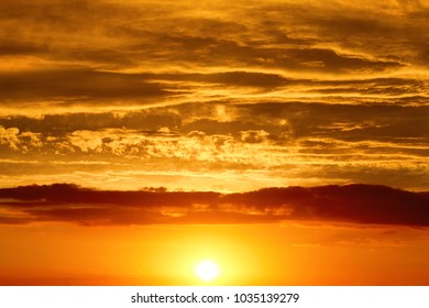 Sunset - the sun low above the horizon