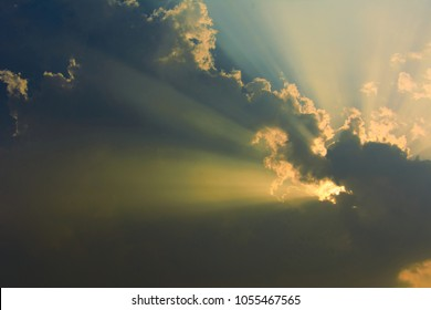 Sunset with sun rays with clouds on the sky. can used for nature background.