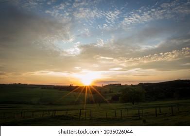 Sunset with sun rays forming a star near Botucatu, Brazil.