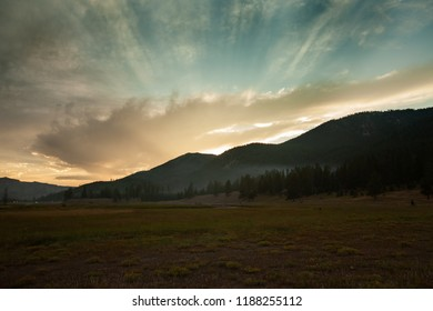 Sunset with sun rays near Madison Campground at Yellowstone National Park in Wymoing