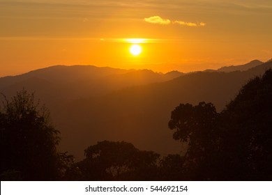 sunset with sun rays on the mountain