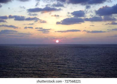 sunset and sun and sea and water and clouds