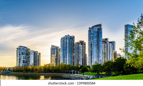 Sunset as the sun is setting behind modern Skyscapers lining the skyline of Yaletown along False Creek Inlet of vancouver, British Columbia, Canada