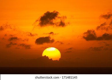 Sunset with the sun setting over the Caribbean Ocean Curacao