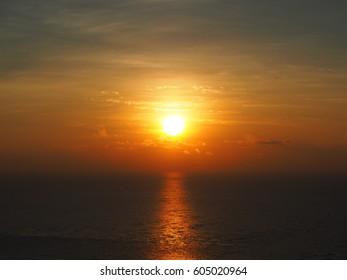 Sunset- The sun is setting, the sun shining on the sea.