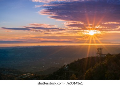 Sunset sunburst over San Francisco bay as seen from Mt Diablo summit, Mt Diablo State Park, Contra Costa county, San Francisco bay area, California