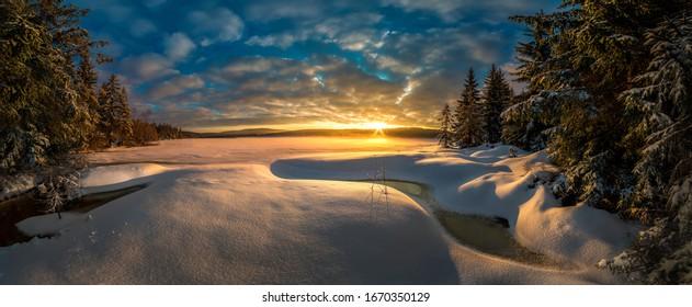 Sunset sunrise in Cerna Nisa dam near Bedrichov city in Jizera Mountains, Czech Republic, the best photo, winter and frost. - Shutterstock ID 1670350129