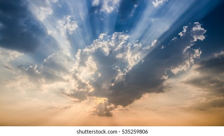 Sunset or sunrise with cloud and ray light on blue sky