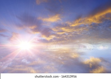Sunset / sunrise with clouds, light rays and other atmospheric effect - Shutterstock ID 164313956