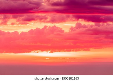 The sunset or sunrise. The cloudy sky cloured in red, orange, rose, scarlet, crimson, purple, violet and blue bright and vivid coloures in the evening or in the morning