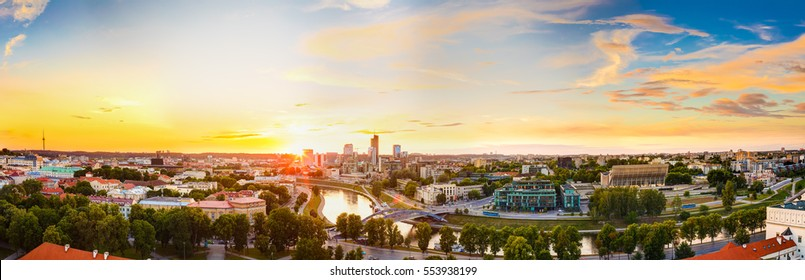 Sunset Or Sunrise Over Cityscape Of Vilnius, Lithuania In Summer Season. Beautiful Panoramic View In Evening. Dramatic Colorful Sky. Travel Panorama