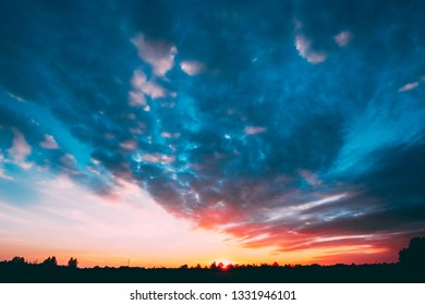 Sunset, Sunrise Over Forest. Bright Dramatic Sky And Dark Ground. Countryside Landscape Under Scenic Summer Dramatic Sky In Sunset Dawn Sunrise. Skyline.