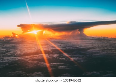 Sunset Sunrise Over Mountains From Height Of Airplane, Plane. Bright Blue, Orange, Yellow And Blue Colors Of Sunrise Sky Background. Warm And Cold Colors.
