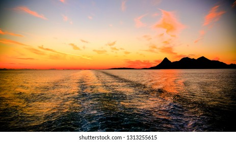 Sunset and sunrise over the sea and Lofoten archipelago from the Moskenes - Bodo ferry in Norway
