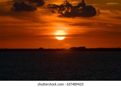 Sunset sunrise red orange yellow sky sun clouds