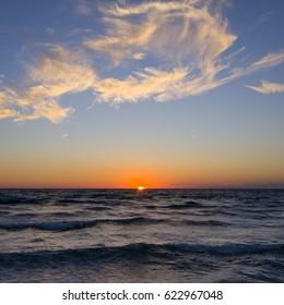 Sunset or sunrise at the sea
