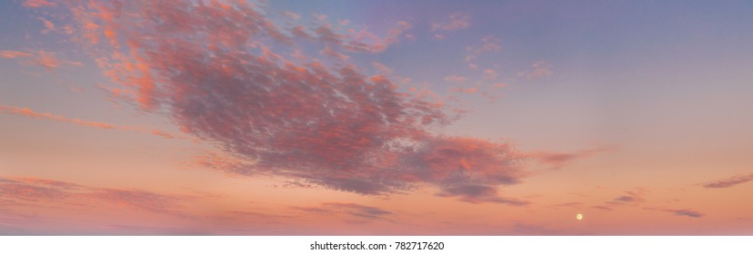 Sunset Sunrise Sky Background. Natural Bright Dramatic Sky In Sunset Dawn Sunrise. Yellow And Pink Colors. Panoramic View