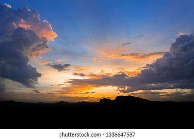 Sunset and sunrise sky background with silhouette mountain.