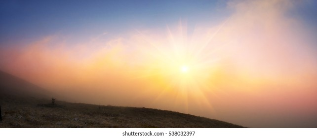 Sunset and sunrise spectacular natural phenomena in the cloud colorful combinations of colors and shades - refraction of sunlight spectrum of the sun low on the horizon at the of the day