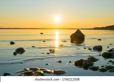 Sunset or sunrise view above the tranquil water in the lake Chiemsee near Bavarian Alps mountains, Germany