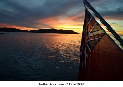 Sunset from super yacht with English flag