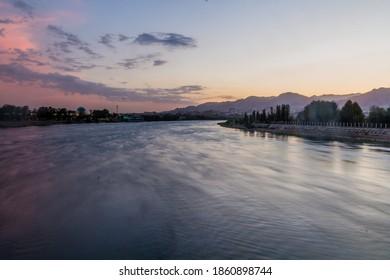 Sunset at Syr Darya river in Khujand, Tajikistan - Shutterstock ID 1860898744