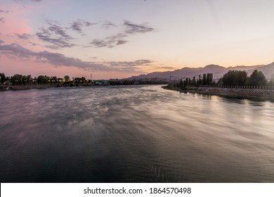 Sunset at Syr Darya river in Khujand, Tajikistan - Shutterstock ID 1864570498
