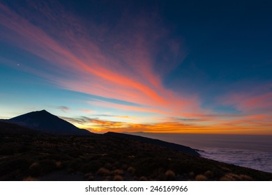 Sunset in the Teide National Park, Tenerife/Spain. On the left is the Vulcano Teide and on the right the Atlantic Ocean. The Moon is shining over the Vulcano.