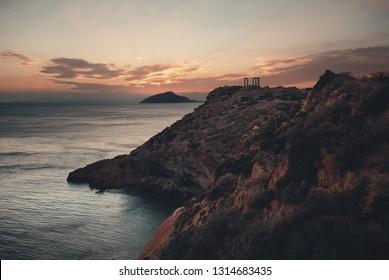 Sunset at Temple of Poseidon near Athens, Greece.