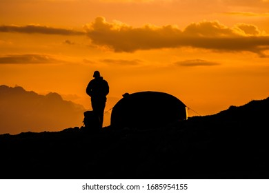 Sunset and Tent in Mountains