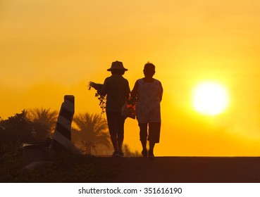 sunset with thai people