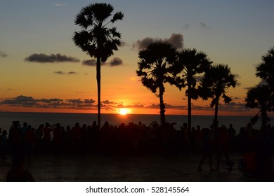 Sunset in Thailand with crowd