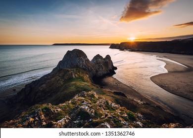 Sunset at Three Cliffs Bay, Gower, Peninsula, Swansea, South Wales, UK